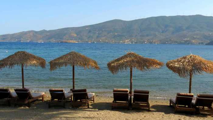 Greece, Greek island, Saronic island, Poros, Poros Greece, Poros island, beach, Colona Beach Poros, Askeli beach, lounge chairs, sunbeds, sea, coast, shore,