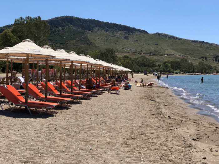 Greece, Peloponnese, Nafplio,Karathona, Karathona beach, beach, bay, seaside, shore, coast, sunbeds, loungers, beach umbrellas,