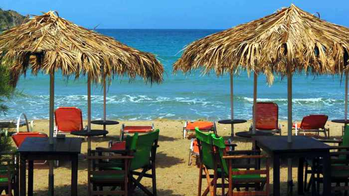 Greece, Greek Islands, Cyclades, Siros, Syros, Kini Bay, Kini beach, Kini village, landscape, coast, seaside, beach, Kini Beach, Kini Beach Syros,, chairs, beach chairs, beach umbrellas, sea, sand,