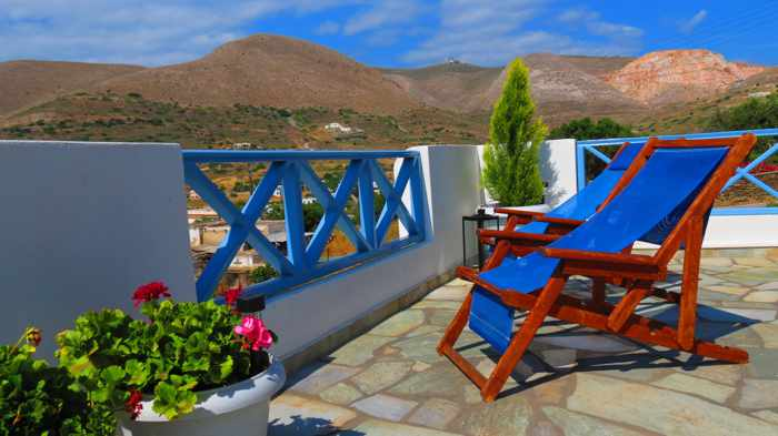 Greece, Greek Islands, Cyclades, Siros,Syros, Syros island, building, terrace, patio, lounge chairs, Kini Bay Rooms and Apartments,
