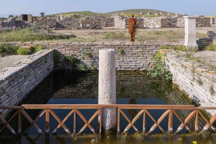 Photograph of the Antony Gormley sculpture Cast III on Delos island