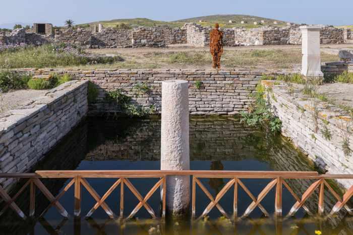 Photograph of the Antony Gormley sculpture Cast III on Delos island