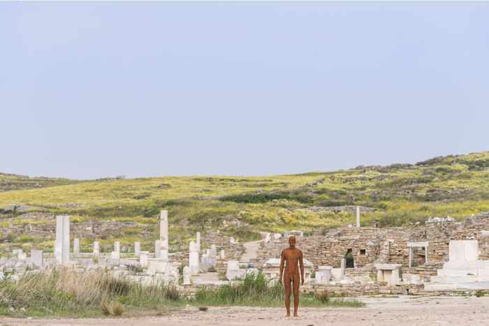 From the NEON page on Instagram a photo of an Antony Gormley sculpture positioned in the ruins on Delos island Greece
