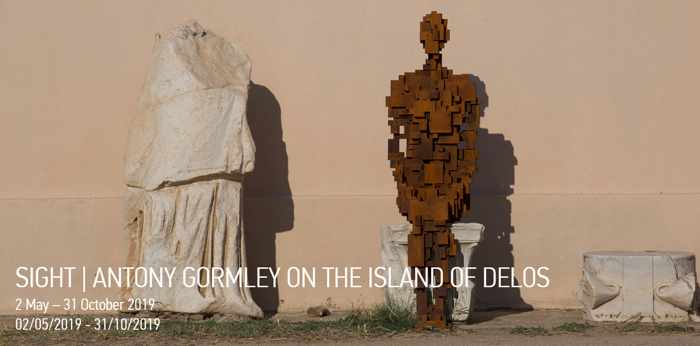 One of the Antony Gormley iron sculptures on Delos island in 2019