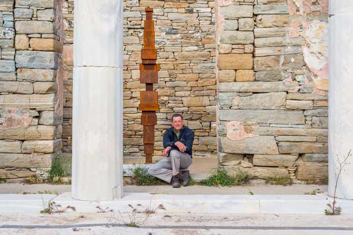 Sir Antony Gormley and one of the sculptures in his SIGHT installation on Delos as seen in a photo from the NEON page on Facebook