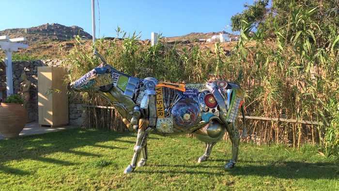 Contemporary art sculpture in the garden at Blue Fusion Art Restaurant Mykonos