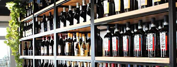 I Frati Mykonos wine racks photo from the restaurant Facebook page