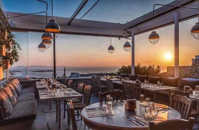 Olive Tree Mykonos dining terrace photo from its Instagram page