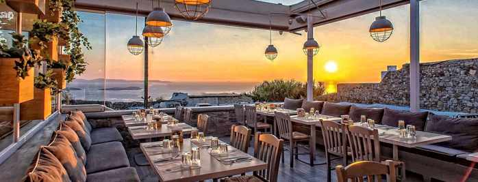 Olive Tree Mykonos sunset view dining terrace photo from the restaurant page on Facebook