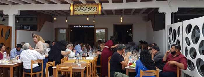 Open air dining patio at Taverna Kandavlos on Mykonos