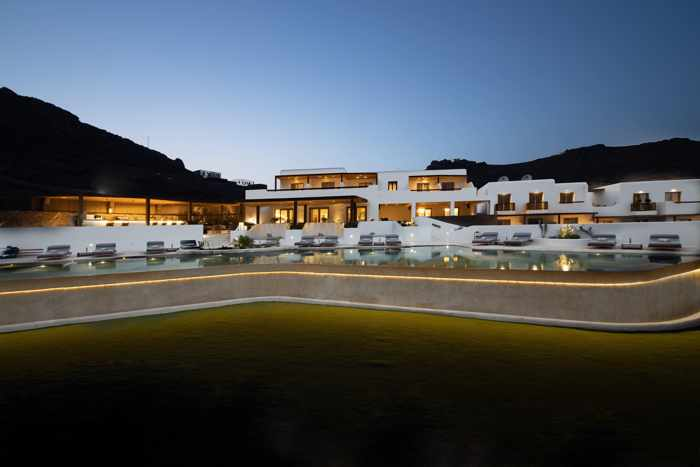 Aegon Mykonos Facebook page photo showing the hotel and pool at twilight