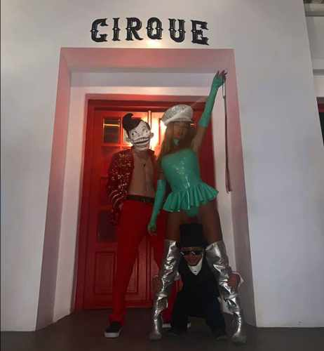 Entertainment acts pose in front of the entrance to Cirque Mykonos nightclub