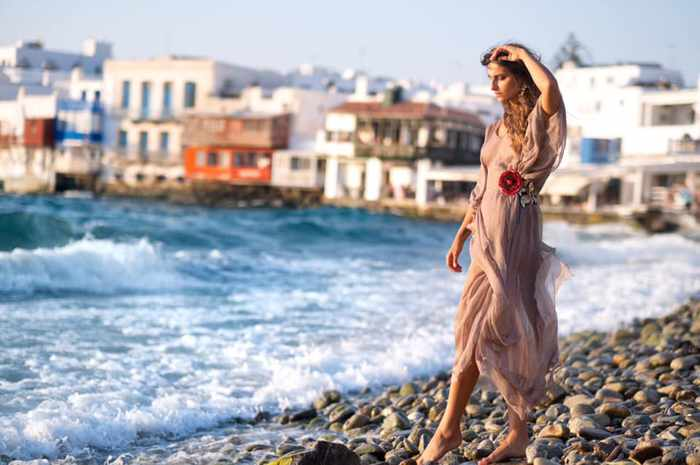 Model wears a Dassios dress at the Little Venice seafront of Mykonos Town