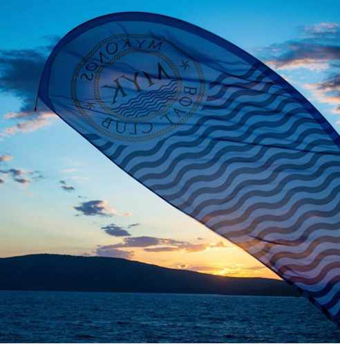 Mykonos Boat Club social media photo of a sunset view of Rhenia island