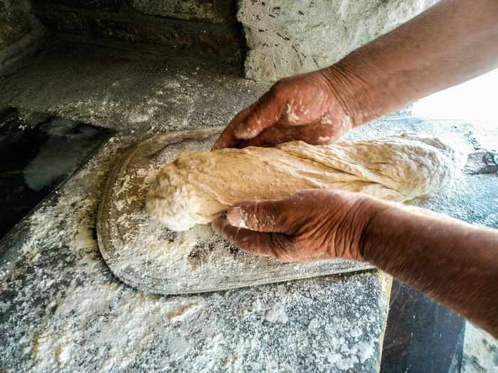 Rizes Folklore Farmstead & Restaurant Mykonos photo of a traditional bread making session