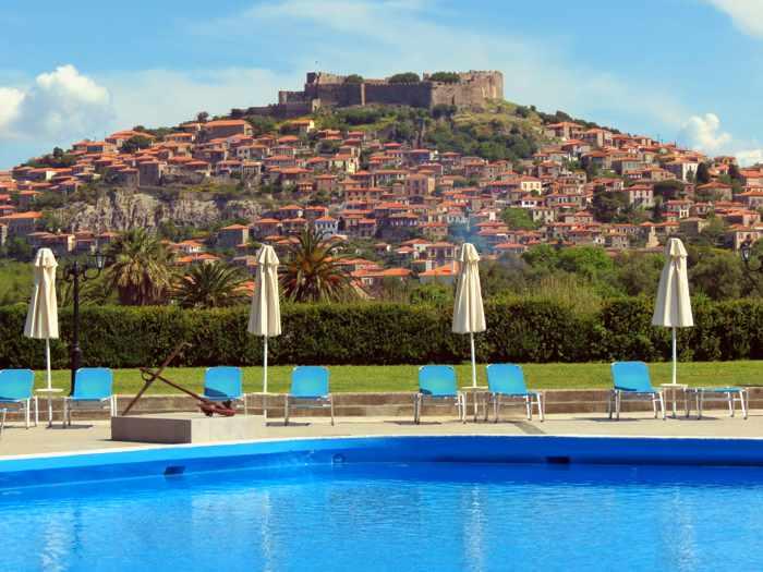 Hotel Delfinia swimming pool view of Molyvos town on Lesvos island