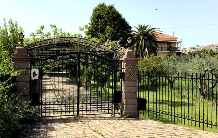 the gated entrance to a private estate at Molyvos on Lesvos island