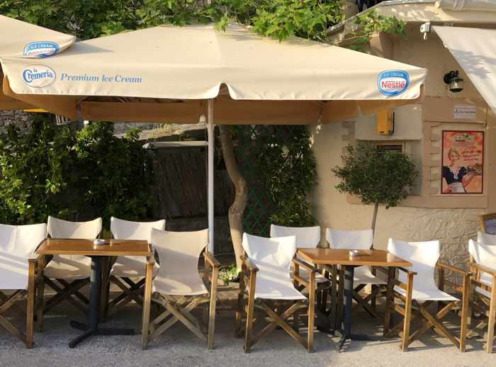 streetside chairs at To Platanaki Cafe in Molyvos on Lesvos island