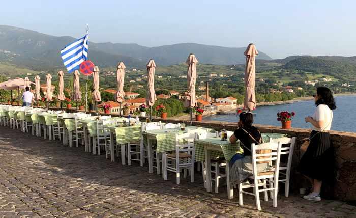 a row of taverna tables in Molyvos on Lesvos island