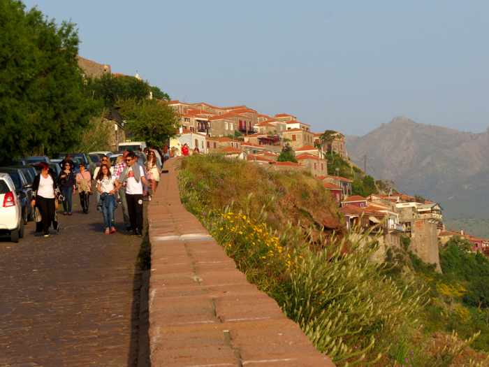 Pedestrians descending the hill on the main street in Molyvos on Lesvos island