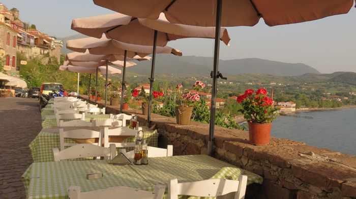 taverna tables along the main road in Molyvos on Lesvos island