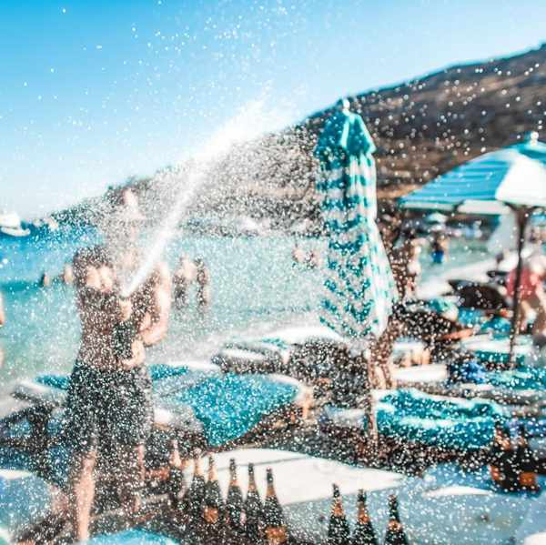 Nammos Mykonos champagne spray photo shared on social media