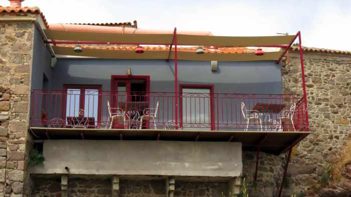 a balcony overlooking Agios Nikolaos Church at Molyvos harbour