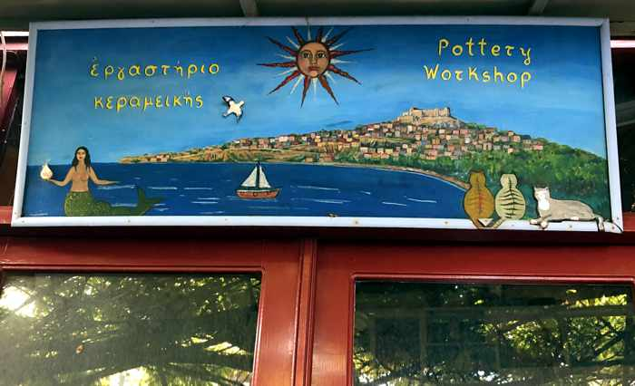 sign above the entrance to a pottery workshop in Molyvos on Lesvos island