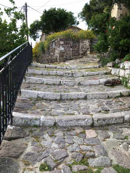 flight of stone steps on a hillside in Molyvos on Lesvos island