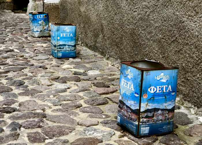 old feta cheese containers in a lane in Molyvos on Lesvos island