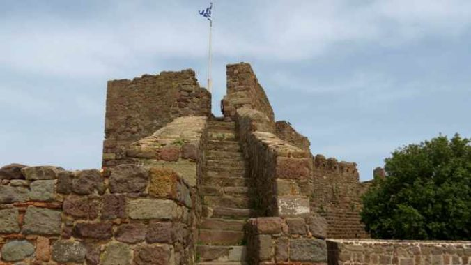 Tower and flag pole in the Castle of Molyvos on Lesvos island