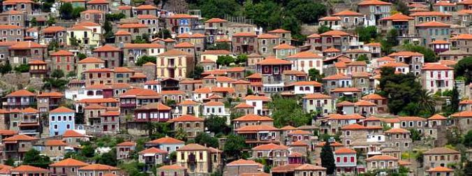 buildings cling to the steep hills below the Castle of Molyvos on Lesvos