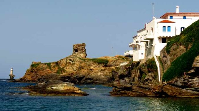 Tourlitis lighthouse ancient Kastro and mansions of Chora on Andros island