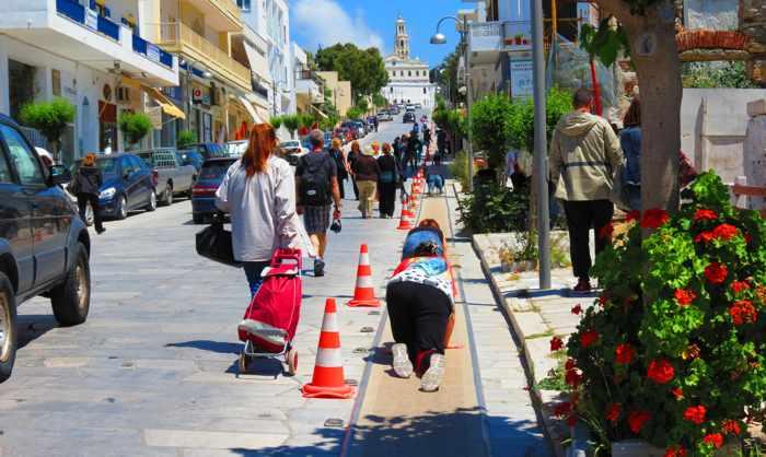 pilgrims crawling uphill to Evangelistria Church on Tinos island