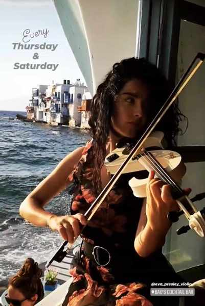 Baos Cocktail Bar Mykonos presents entertainment by violinist Eva Presley