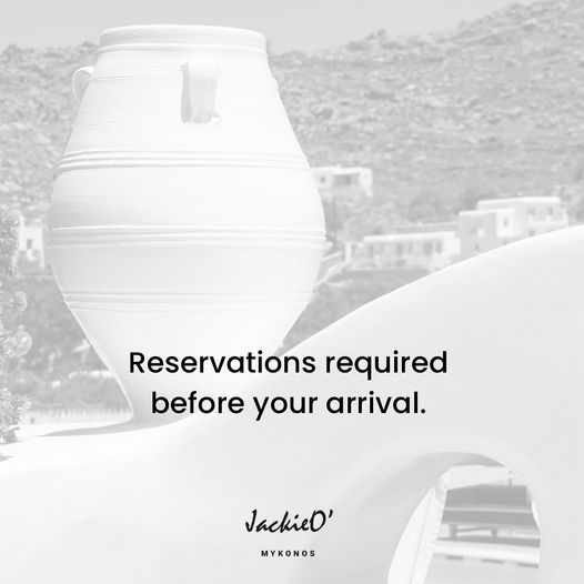 JackieO Mykonos town bar cantina and beach club notice for reservations in August 2021