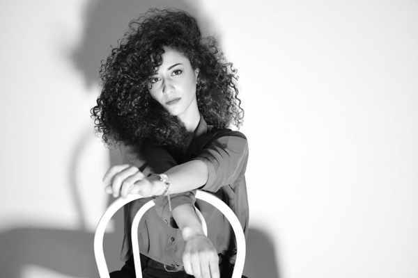 Singer Sarah Harrar seen in a social media post announcing her appearance at 54 Cocktail Lounge & Skybar on Mykonos